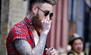 dad1403c0e8 A hipster on the streets of London sports trendy tattoos. Photograph  Wayne  Tippetts Rex Features