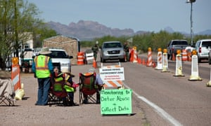 Residents of Arivaca, Arizona, monitor the Border Patrol checkpoint in the town.