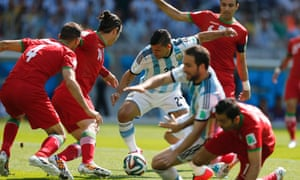 Argentina's Sergio Aguero crowded out by Iran's Andranik Teymourian and Jalal Hosseini.
