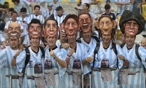 Argentinian fans wear masks of famous Argentine players - can you name them?