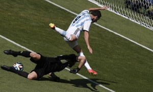 Iran's goalkeeper Alireza Haghighi bravely rushes off his line to deny Higuain.