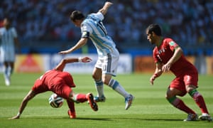 Mehrdad Pooladi and Ehsan Hajsafi try and stop Messi.