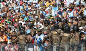 Military police blend in with the crowd at the Mineirao Stadium.