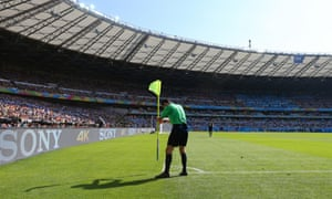 The referee puts the corner flag back in place.