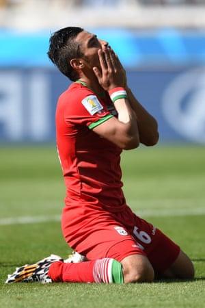 Iran's forward Reza Ghoochannejhad misses a sitter...