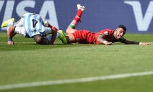 Pablo Zabaleta takes out Ashkan Dejagah...