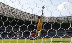 Argentina's goalkeeper Sergio Romero tips a header by Iran's Ashkan Dejagah over the bar.