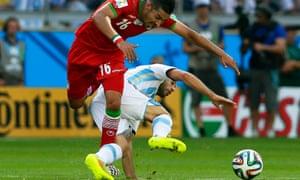 Reza Ghoochannejhad is stopped in his tracks by Javier Mascherano.