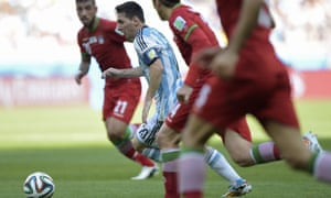 Lionel Messi glides forward with the ball.