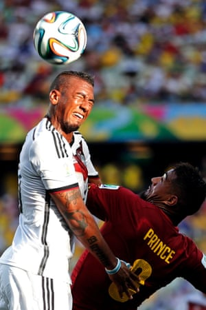 Ghana's Kevin-Prince Boateng, right, challenges his brother Jerome Boateng.