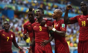 Asamoah Gyan celebrates with his team-mates after scoring Ghana's second.