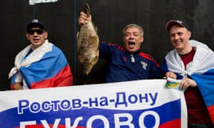 A Russian fan shows off the piranha he has caught before Belgium v Russia World Cup 2014 Group H match at the Maracana stadium in Rio de Janiero on June 22nd 2014 in Brazil (Photo by Tom Jenkins)