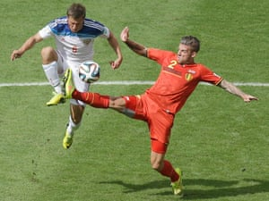 Belgium's Toby Alderweireld, right, challenges for the ball with Russia's Maksim Kanunnikov.