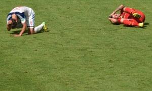Belgium's defender Toby Alderweireld, right, and Russia's forward Maxim Kanunnikov tumble to the ground