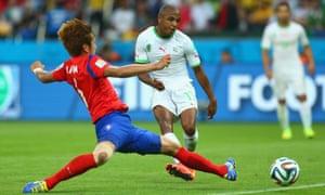 Yacine Brahimi of Algeria scores his team's fourth goal.