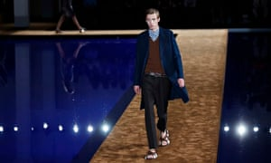 A model wears a creation for Prada's spring-summer 2015 menswear collection.