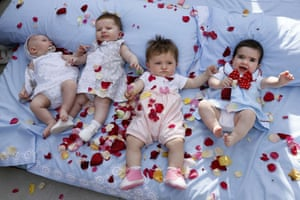 Rose petals cover babies during El Colacho in the village of Castrillo de Murcia. Photograph: Cesar Manso / AFP / Getty Images