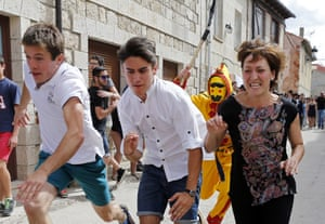 A man dressed up as the devil chases children during El Colacho, the baby jumping festival in the village of Castrillo de Murcia. Photograph: Cesar Manso / AFP / Getty Images