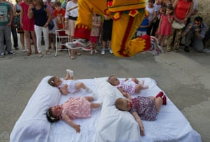 A man representing the devil leaps over babies during El Colacho. Photograph: Denis Doyle / Getty Images