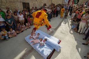 Baby jumping (El Colacho) is a traditional Spanish practice dating back to 1620 that takes place annually to celebrate the Catholic feast of Corpus Christi. Photograph: Denis Doyle / Getty Images