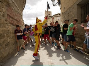 A man representing the devil tries to whip youths during the festival. Photograph: Denis Doyle / Getty Images