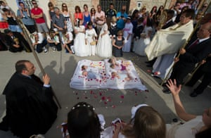 Babies covered in confetti are blessed during el Salto del Colacho in Castrillo de Murcia, Spain. Photograph: Denis Doyle / Getty Images