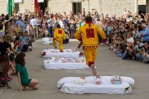 The festival of El Salto del Colacho (the devil's jump) in Castrillo de Murcia, Spain. Photograph: Denis Doyle / Getty Images