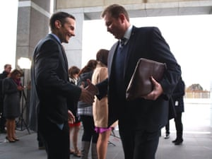 Door bi-partisanship: Liberal member for Reid Craig Laundy greets Labor member for Fraser Andrew Leigh as they cross paths for the morning ritual of speaking to the media outside the House of Representatives doors.