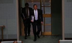 Tony Abbott enters the house for question time.