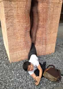 The student waits to be rescued from the giant vagina sculpture
