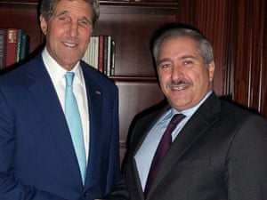Jordanian Foreign minister Naser Judeh greets US Secretary of State John Kerry  in Amman on Sunday.