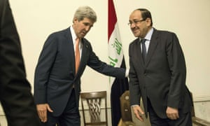 Iraqi Prime Minister Nouri al-Maliki  and US Secretary of State John Kerry meet at the Prime Minister's Office in Baghdad on Monday.