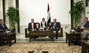 Iraqi Prime Minister Nouri al-Maliki meets US Secretary of State John Kerry at the Prime Minister's Office in Baghdad, in the presence of Iraqi Foreign Minister Hoshyar Zibari