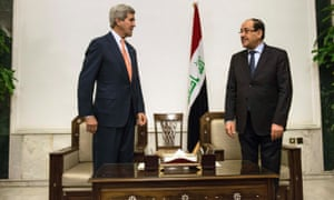 Kerry and Maliki at photocall after their talks in Baghdad.