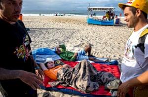 Who needs a hotel? World Cup fans camp on Rio de Janeiros famous Copacabana Beach avoiding the sky-high hotel prices.