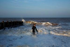 Surfer Tom Everard taking advantage of the large waves at Hornsea.