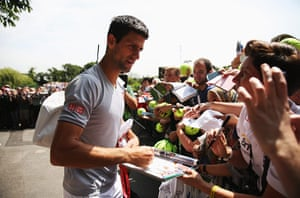 wimbledon day one: Novak Djokovic signs autographs before a practice session