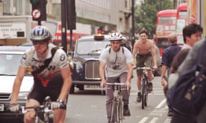 Cyclists traveling along Oxford Street in central London.