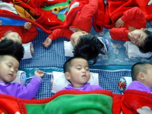 """North Korean triplets sleep at a government-run """"baby home"""" in Wonsan city, Kangwon province, in 2004."""