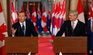 Canadian Prime Minister Stephen Harper (R) and his Australian counterpart Tony Abbott attend a joint press conference at Parliament Hill in Ottawa, Canada on June 9, 2014.