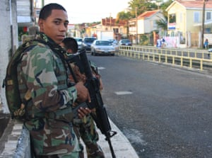 Soldiers are posted in parts of Belize City where gang violence is highest