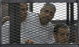 Al-Jazeera's Peter Greste, Mohamed Fahmy and Baher Mohamed listen to the ruling as they are jailed