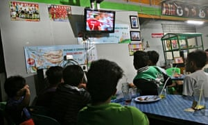 Indonesian fans watch Germany play Portugal