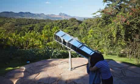Looking though Olafur Eliasson's kaleidoscopic telescope at Inhotim, Belo Horizonte, Brazil