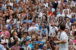 wimbledon first day: Spectators stretch to catch the sweat bands