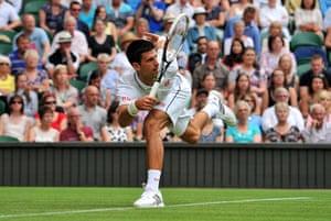 wimbledon first day: Serbia's Novak Djokovic returns