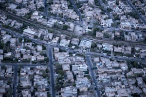 A photo taken on board a helicopter shows parts of the Iraqi capital Baghdad Monday, June 23, 2014.