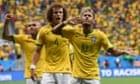 Brazil's forward Neymar celebrates after scoring against Cameroon.