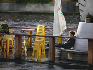 A bar is flooded after heavy weather in Melbourne
