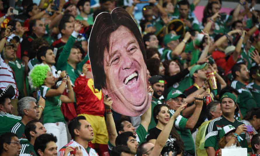 Mexico's fans hold up a cardboard cutout of Herrera  in Recife.